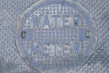 Water meter installation resumes as residents clean up