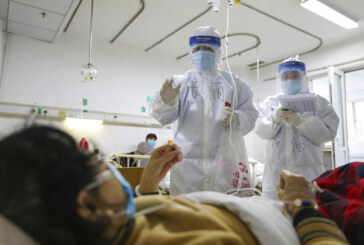 Virus cases surge after China revises the way the count is tallied