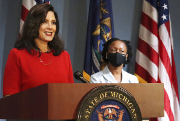 13 charged in plots against Michigan governor, police
